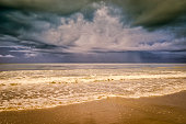 Dramatic thunderstorm clouds over the ocean