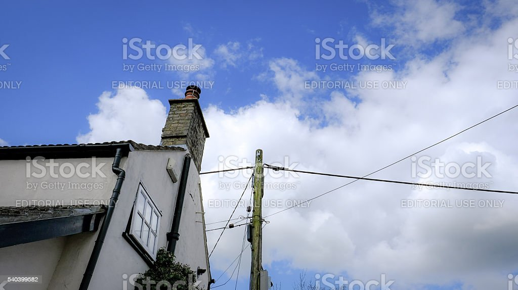 Dramatic view of a cottage with newly power cables stock photo
