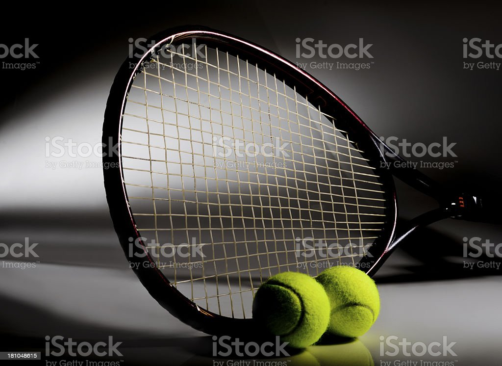 Dramatic view of Tennis Racket and balls royalty-free stock photo