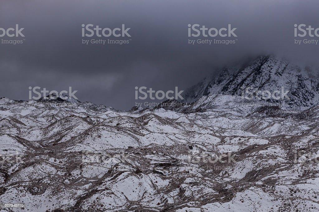 Dramatic view over gloomy Ngozumpa glacier in Sagarmatha stock photo