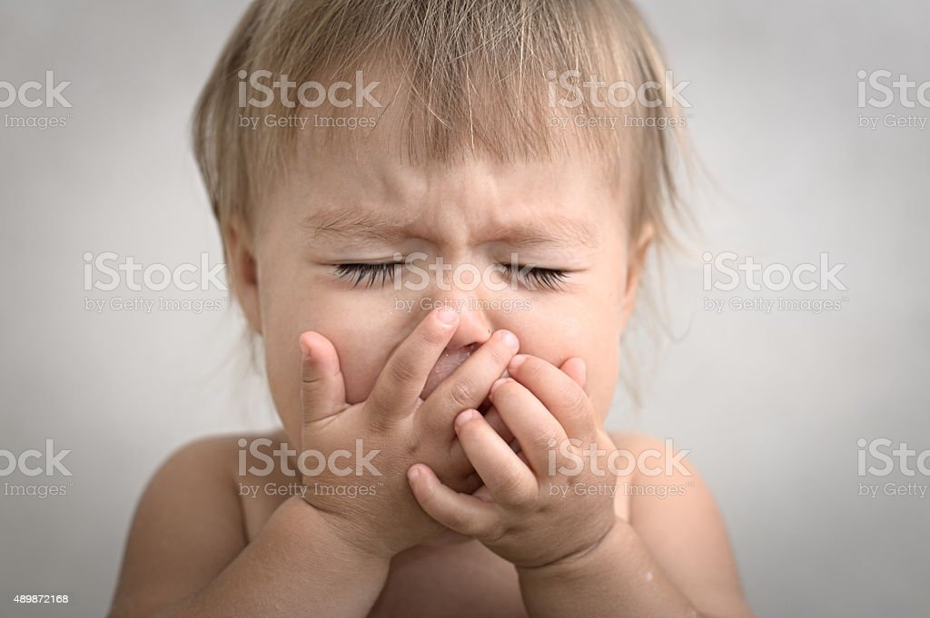 dramatically crying baby portrait stock photo