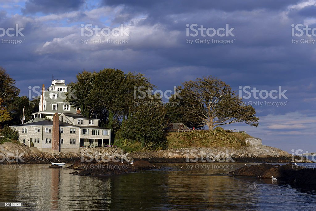 Dramatically lit house on the coast in historic marblehead massa stock photo