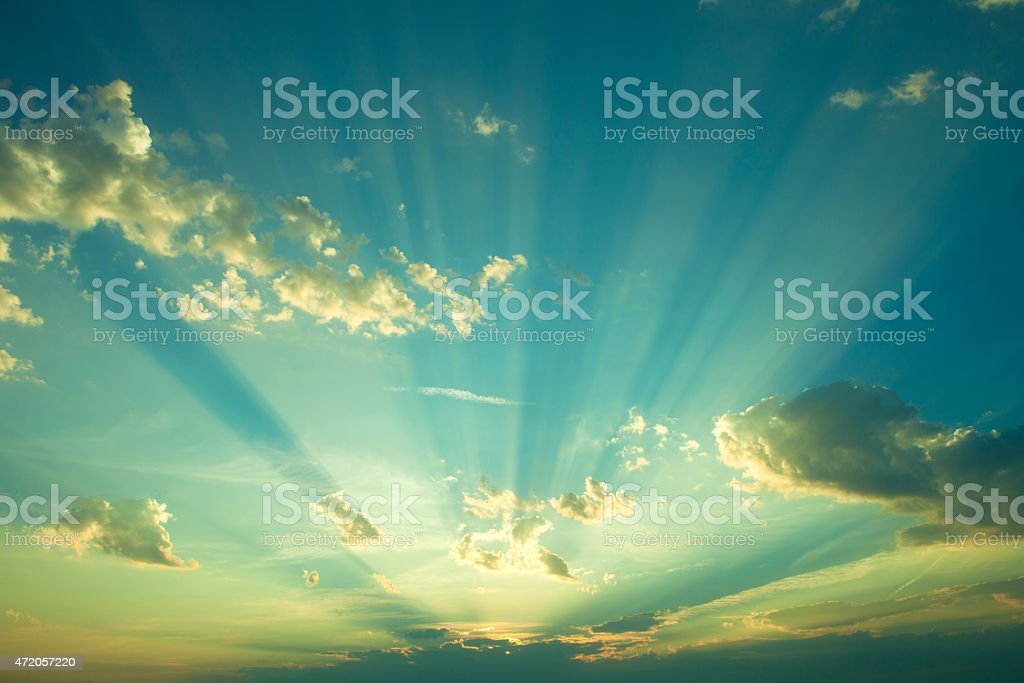 Dramatically lit sky at sunrise stock photo