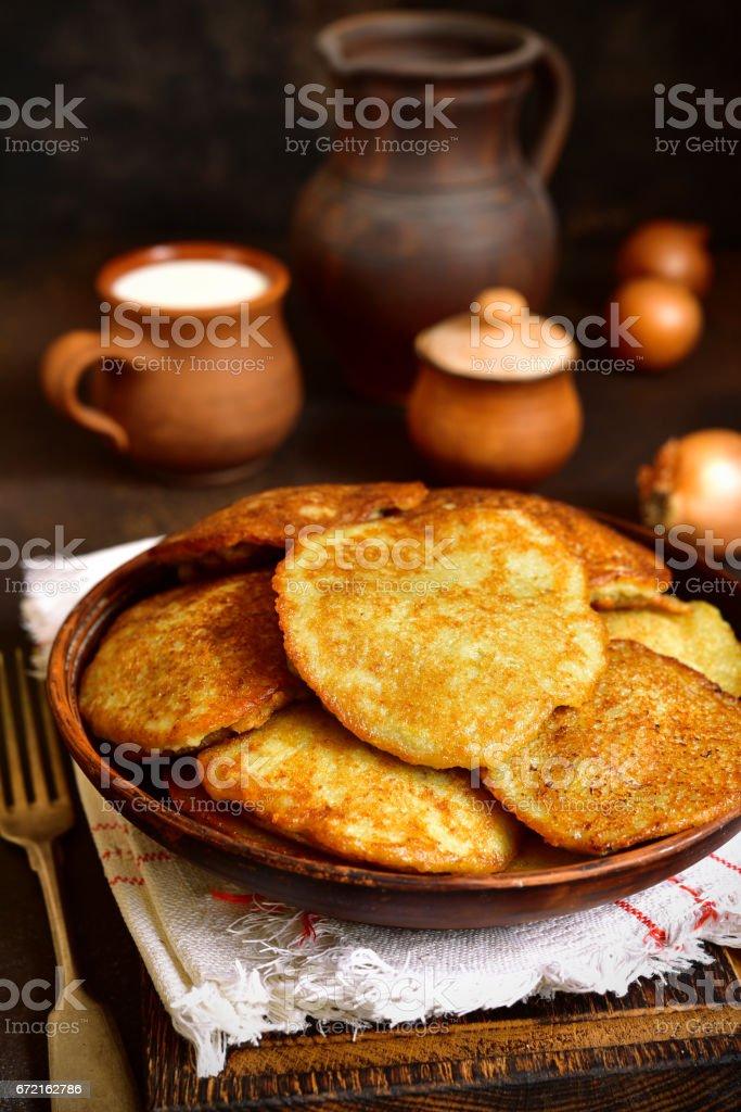 Draniki - potato pancakes stuffed with minced meat stock photo