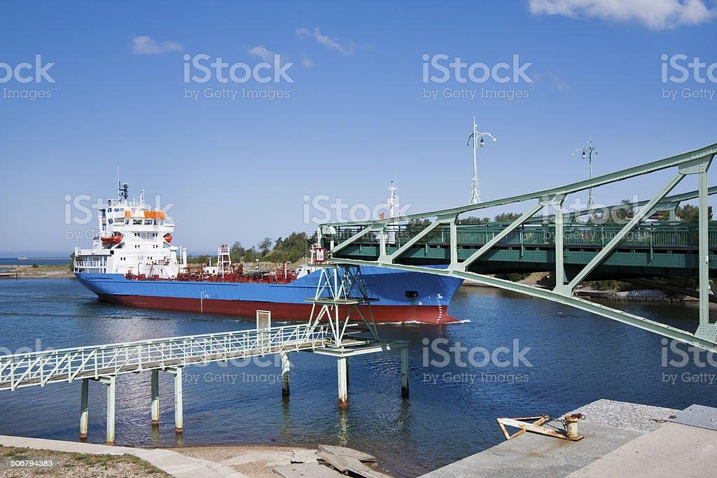Drawbridge and cargo ship stock photo