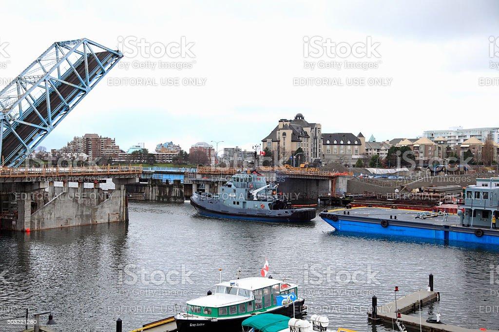Drawbridge Bridge Open To Allow Passage Of Barge And Tug stock photo