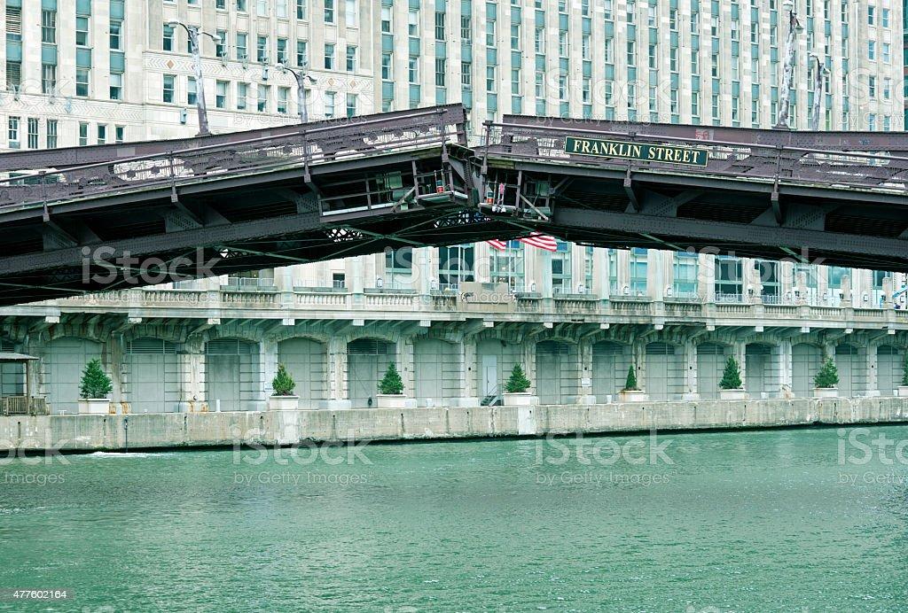 Drawbridge closing over river in downtown Chicago IL stock photo