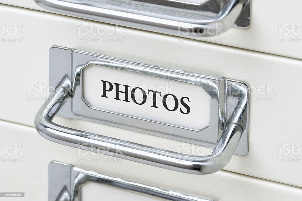 Drawer cabinet with the label Photos stock photo