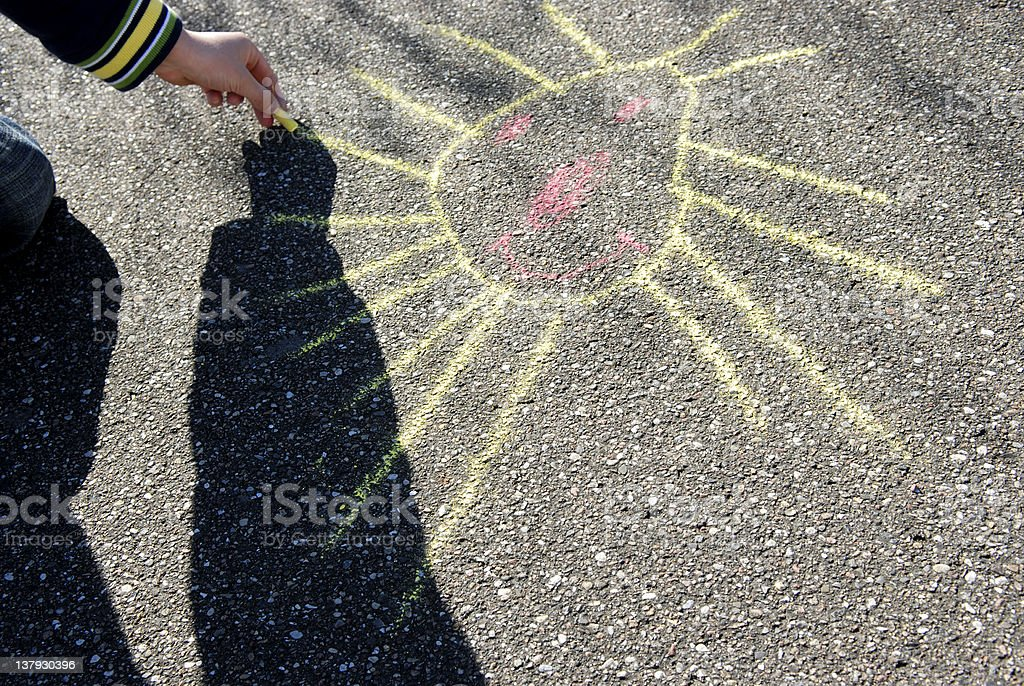Drawing a happy sun royalty-free stock photo