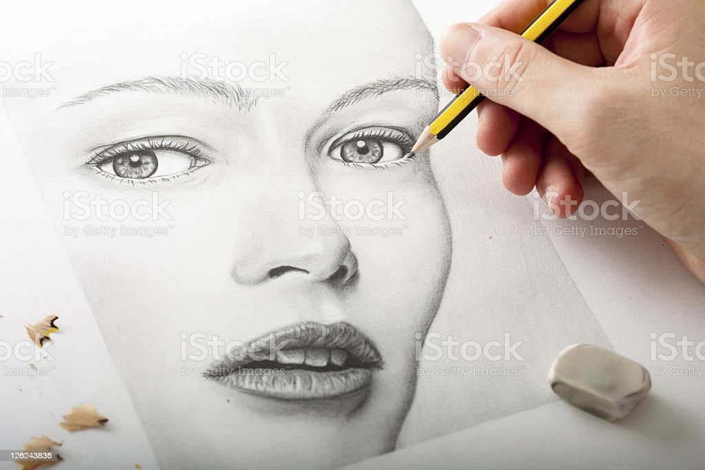 Drawing a Woman Face stock photo