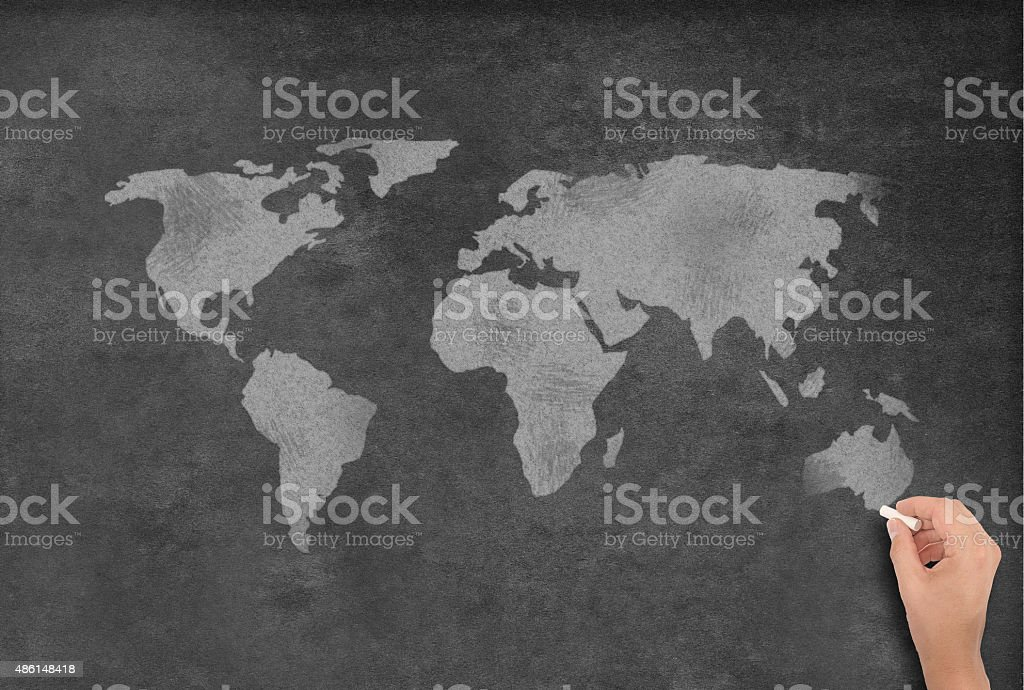 Drawing a World Map on a Blackboard. Professional digitally created...