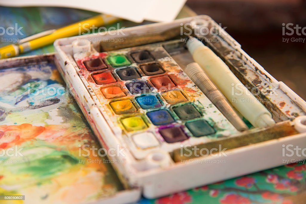 drawing and art: watercolor paint, brushes, colored pencils stock photo