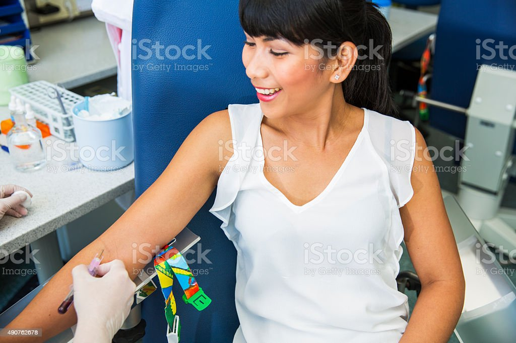Drawing blood...blood capture from a vein for laboratory analyses. stock photo