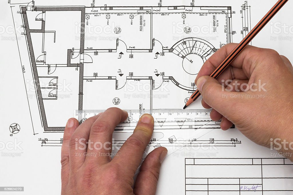 Drawing blueprint with triangle ruler and pen stock photo