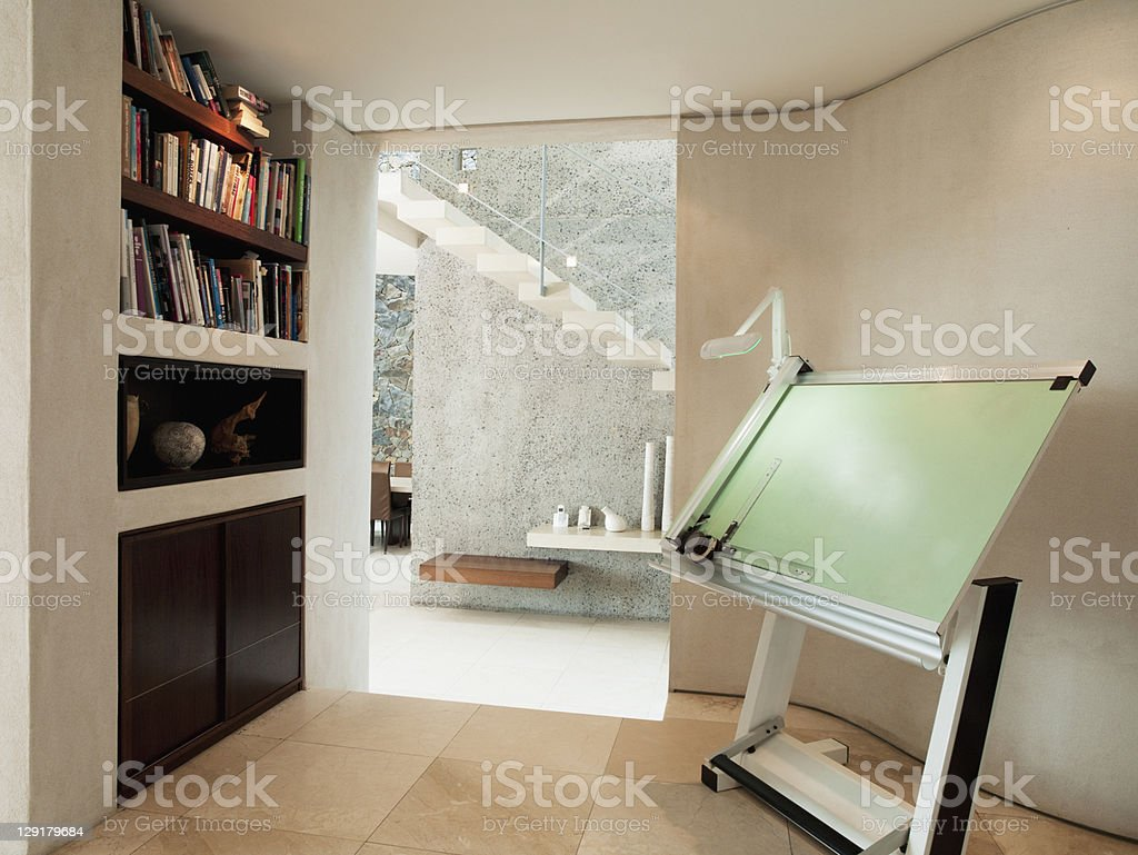 Drawing board and bookshelf in luxury home stock photo