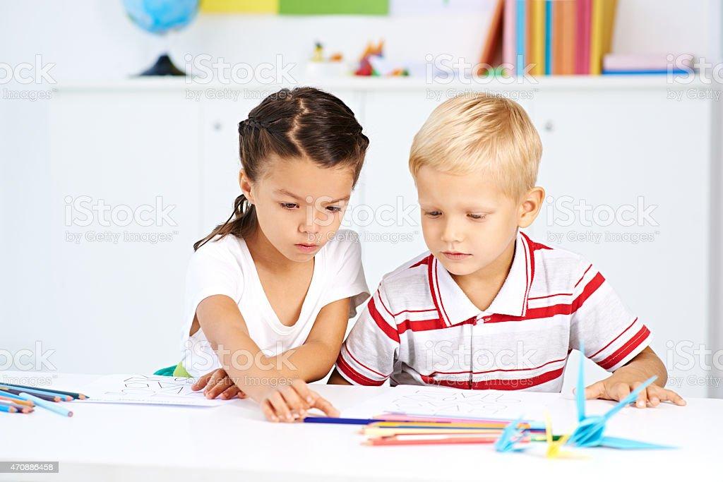 Drawing classmates stock photo