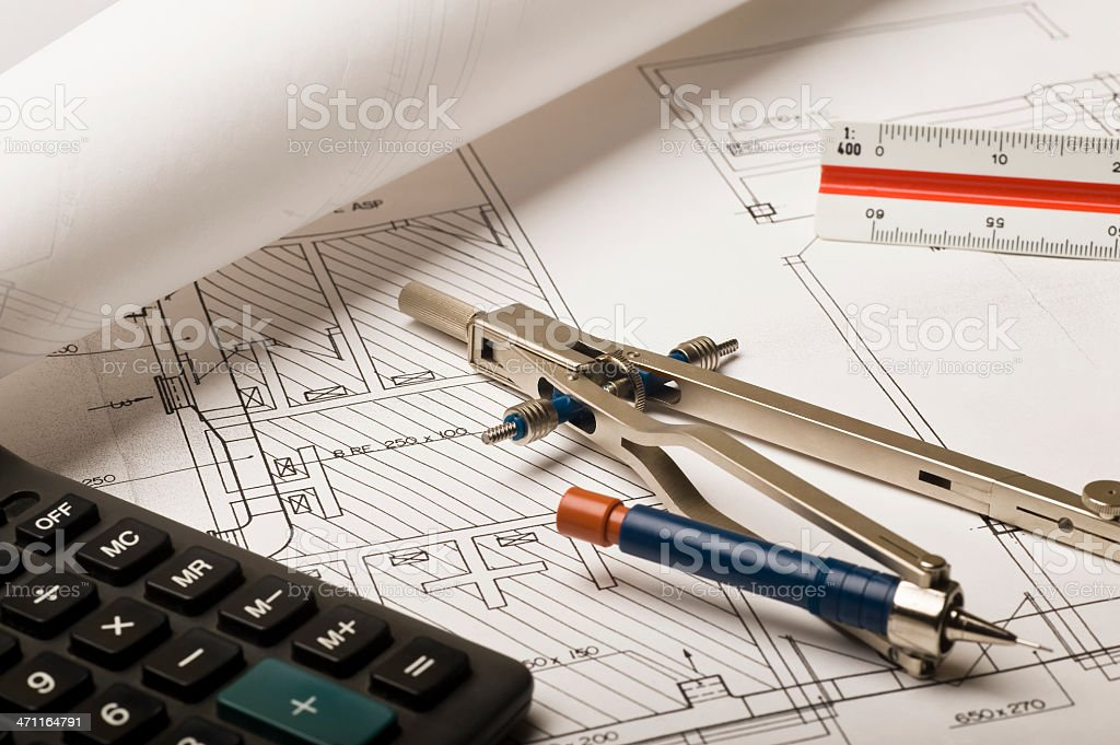 Drawing compass and blueprints royalty-free stock photo