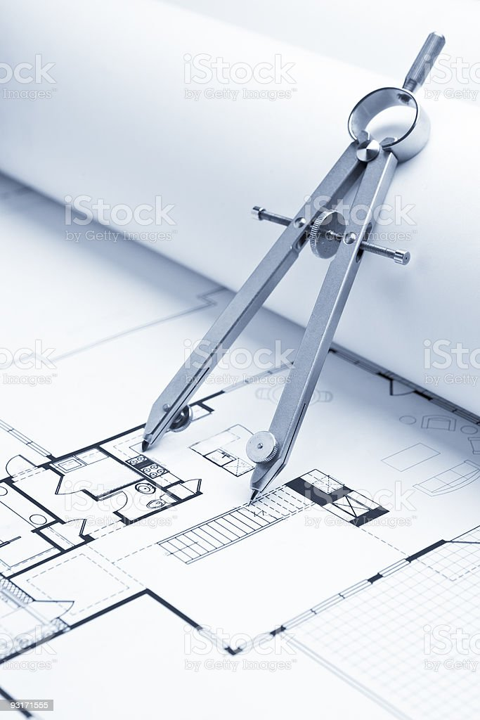 Drawing Compass on Blueprint Floorplans royalty-free stock photo
