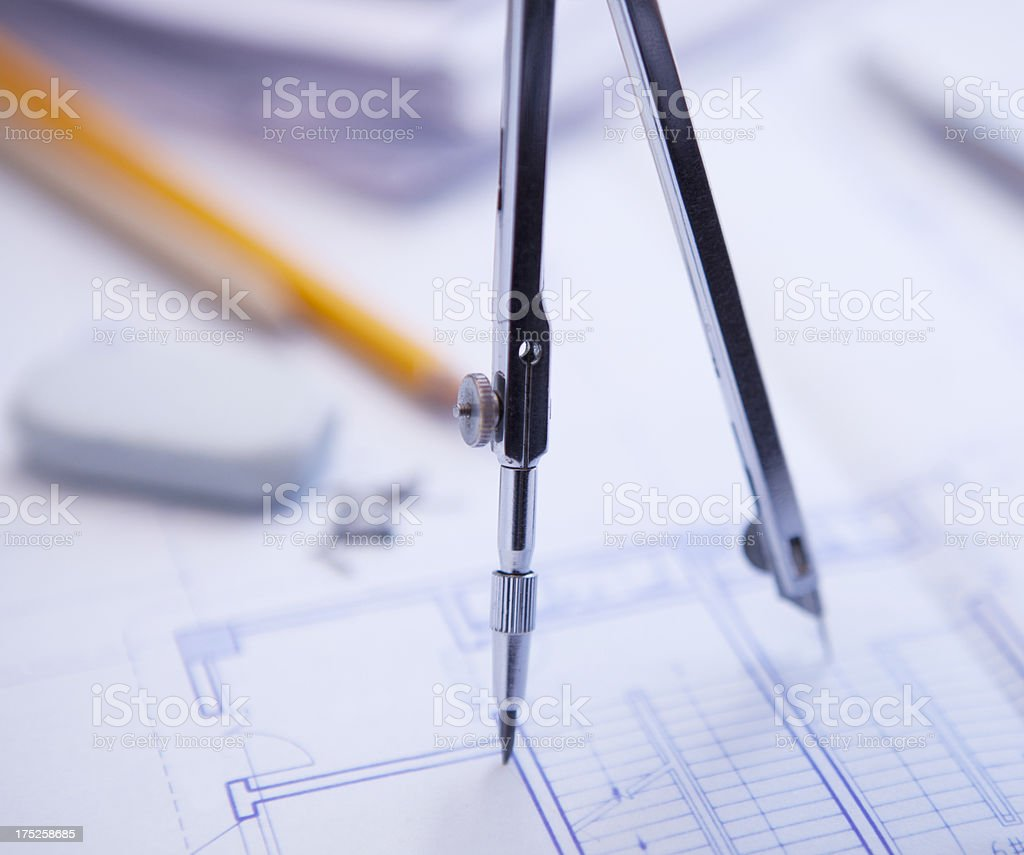 drawing compass on blueprints royalty-free stock photo