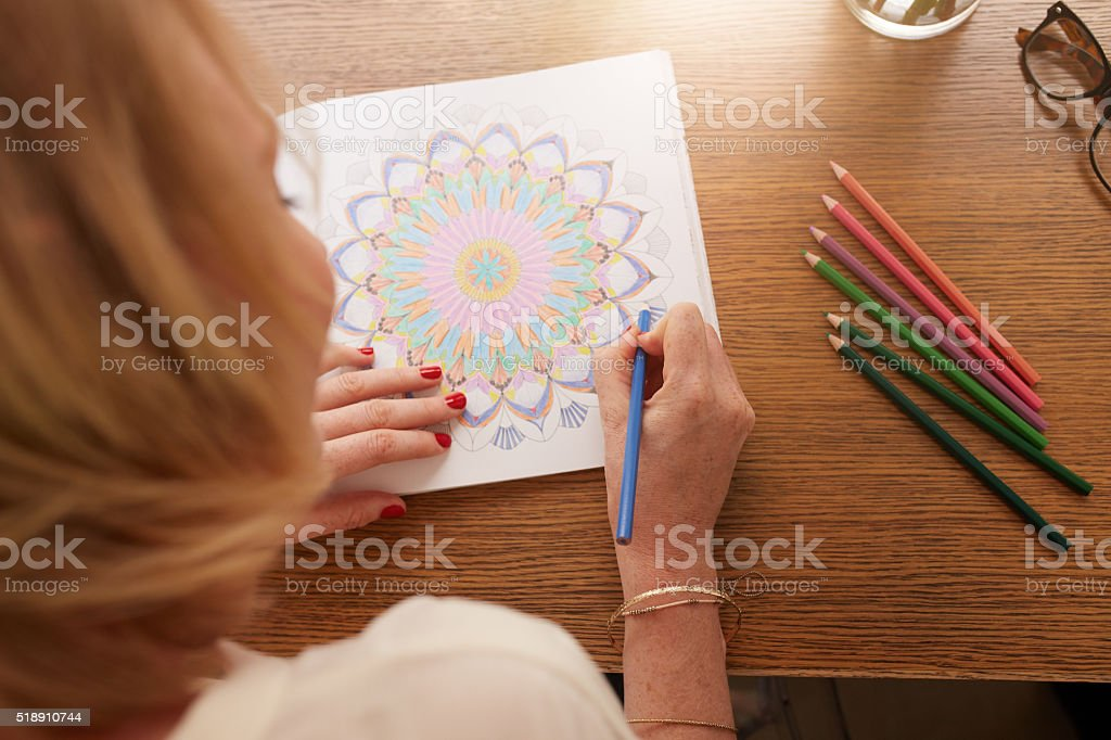 Drawing in adult coloring book stock photo