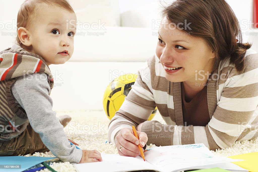 Drawing lesson, mother and son with felt pens at home. royalty-free stock photo