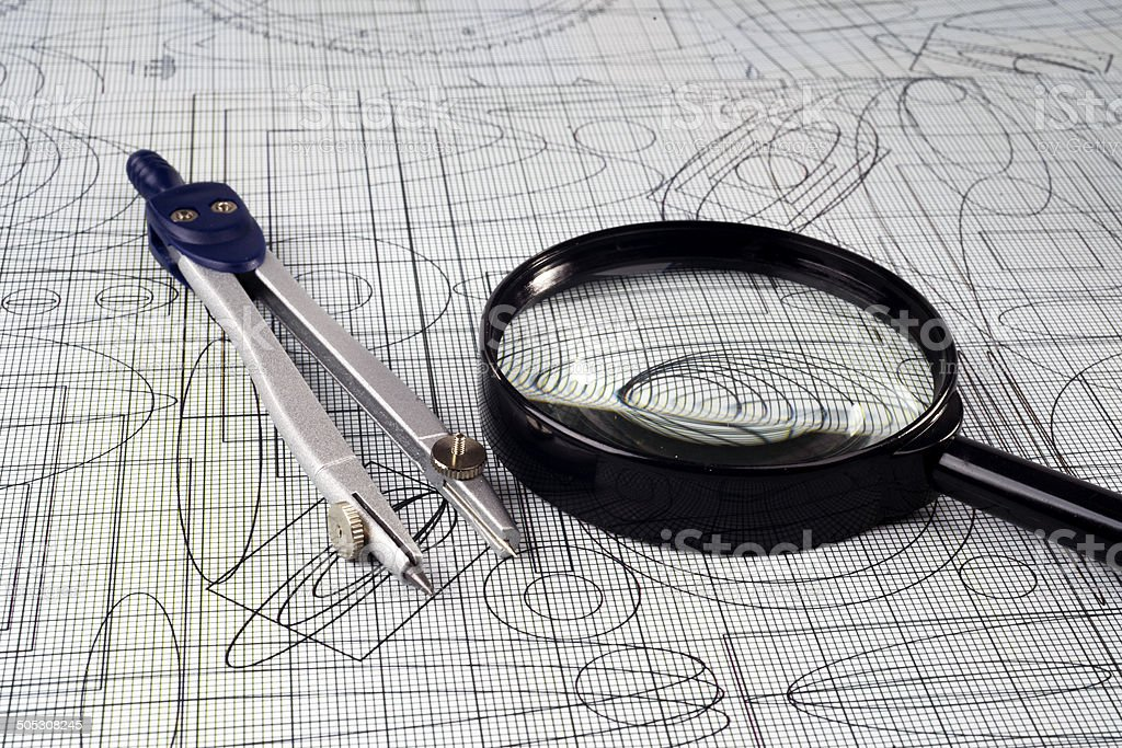 drawing,  magnifying glass and compasses, selective focus royalty-free stock photo