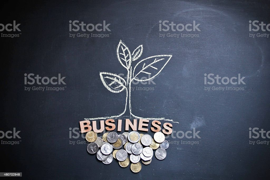 Drawing of a plant with currencies and concept stock photo