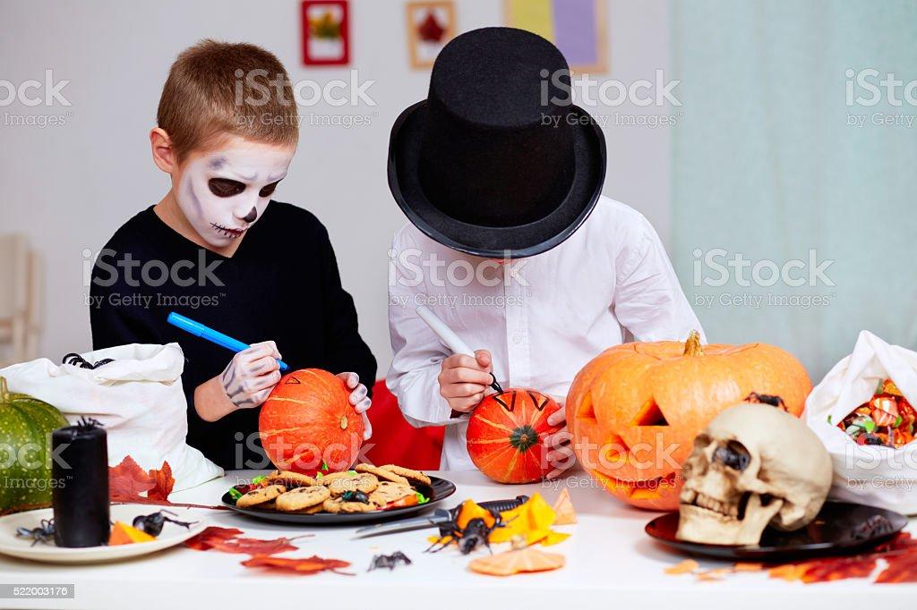 Drawing on pumpkins stock photo