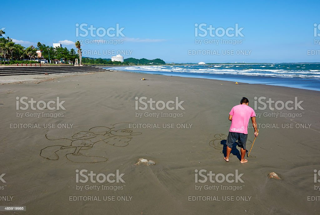 Drawing on Sand stock photo