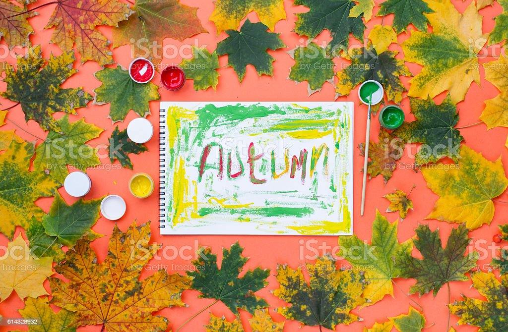 Drawing on the album - the word autumn stock photo
