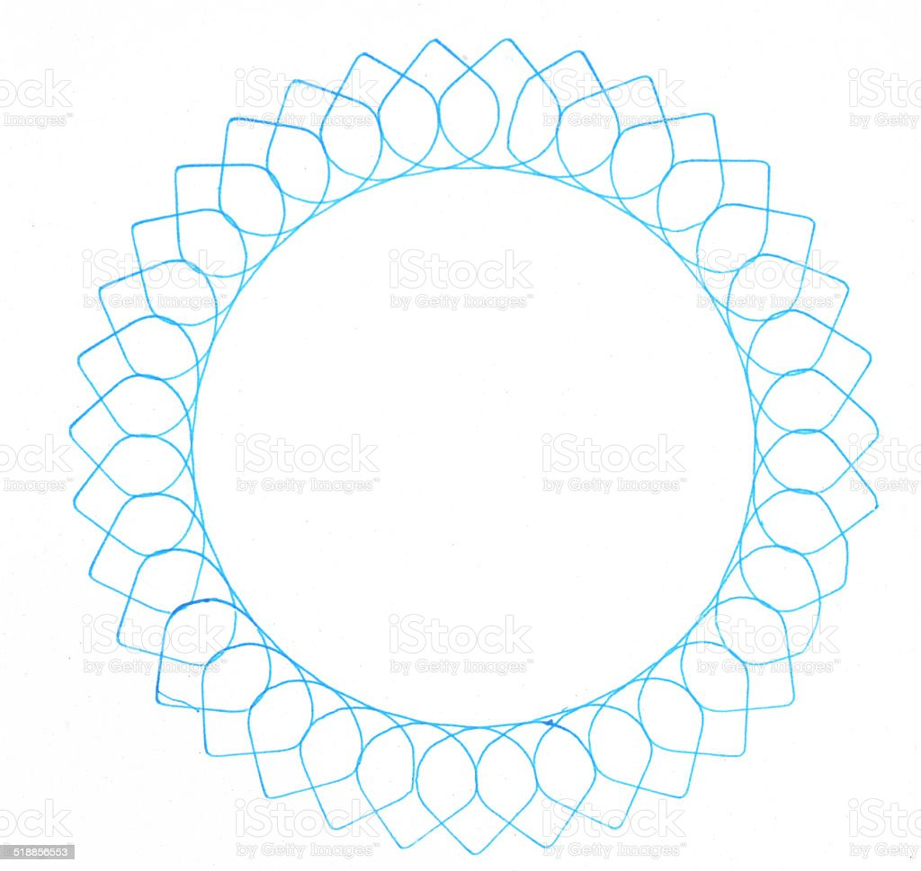 drawing spirograph on white paper stock photo