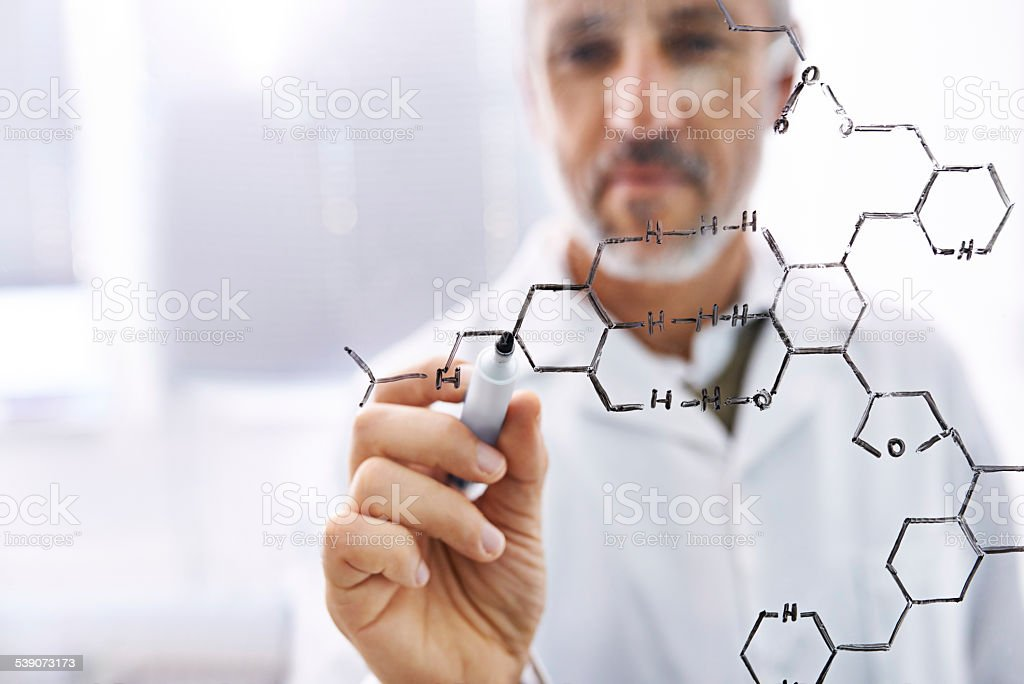 Drawing the molecular structures of his formulae stock photo