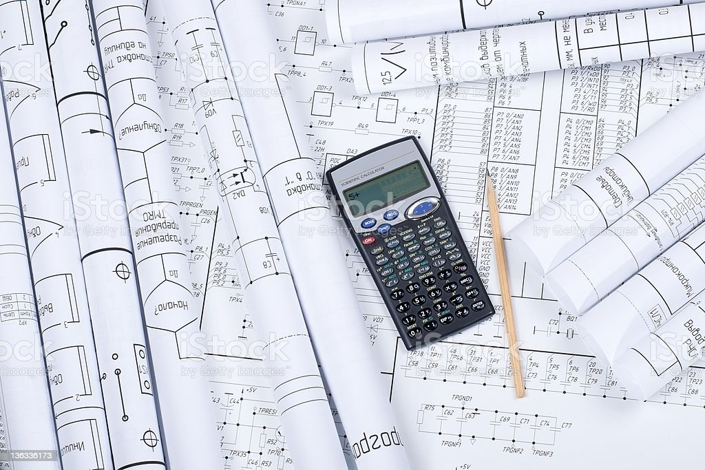 Drawings rolled in a tube, calculator, pencil royalty-free stock photo