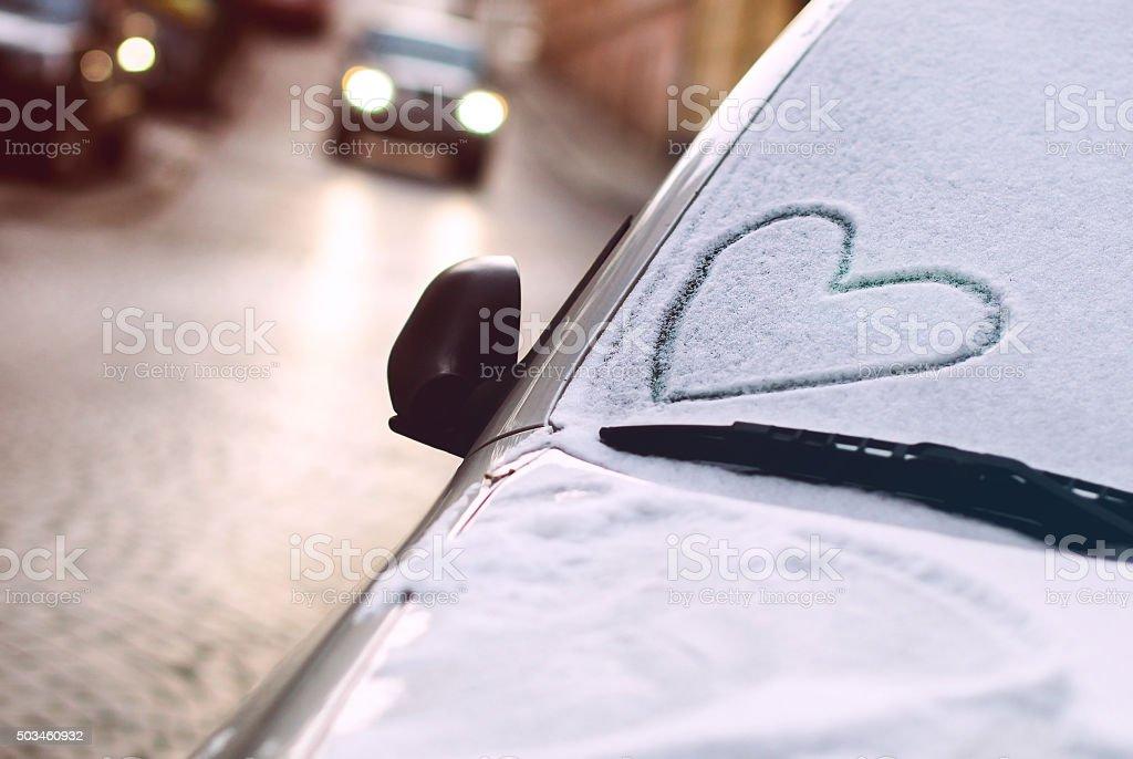 Drawn heart on a car windscreen stock photo