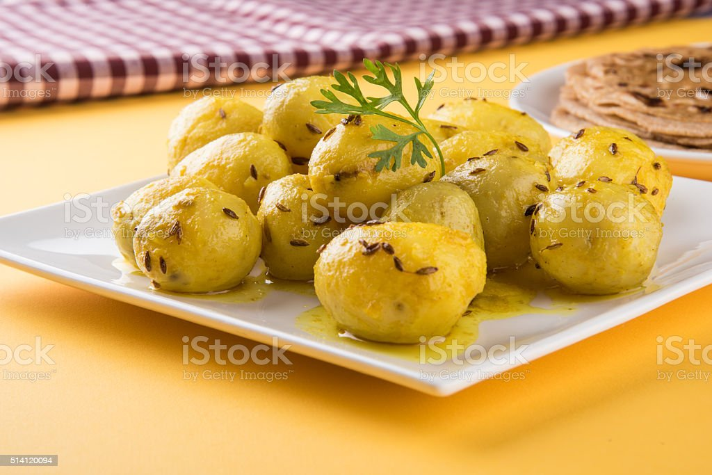dray potato curry or aalu bhaji  with chapati or paratha stock photo