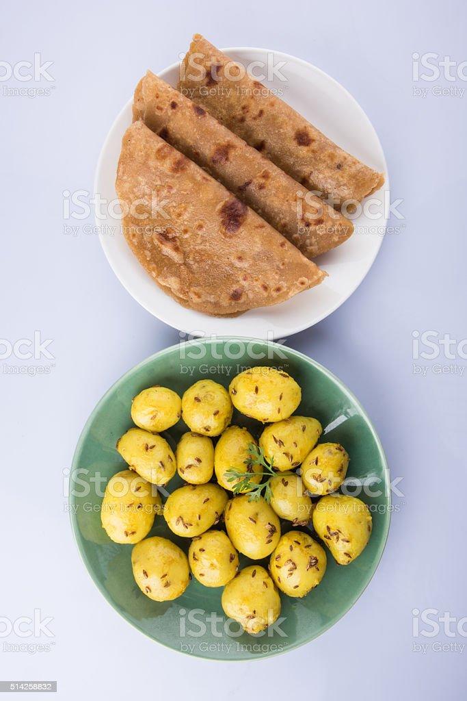 dray potato curry or aalu bhaji  with chapati or paratha stock photo