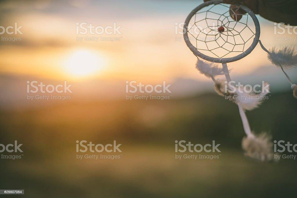 Dream catcher against the rising sun stock photo