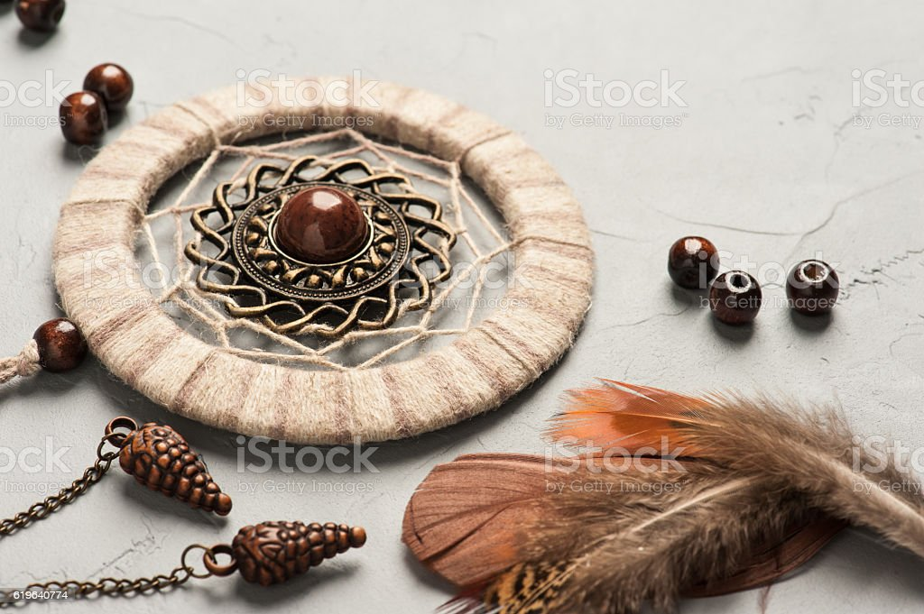 Dream catcher feathers and beads stock photo
