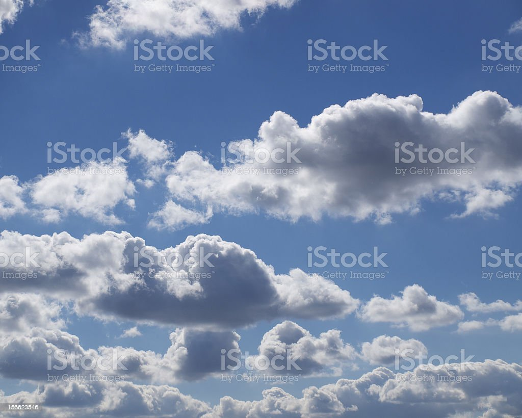 Dream Clouds floating together in deep blue sky royalty-free stock photo