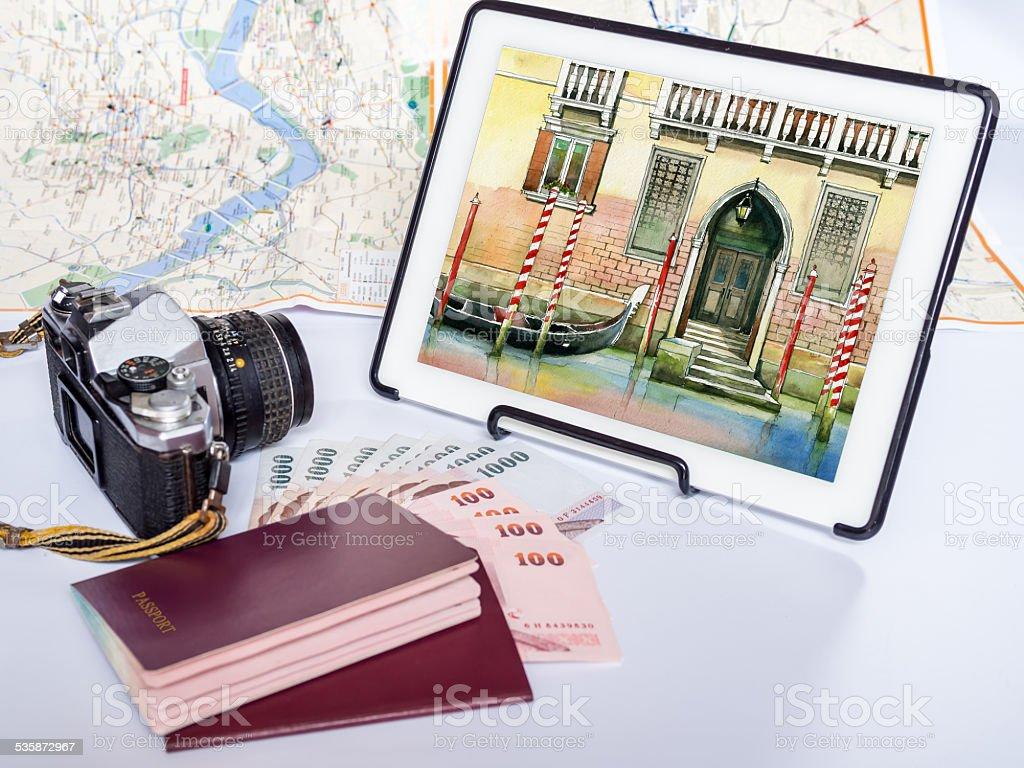 Dream destination sketch on tablet, passport book/  holiday saving concept stock photo