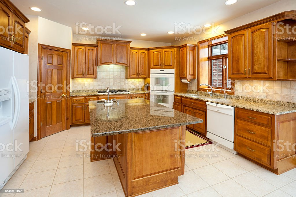Dream Kitchen With Granite Counters, Hardwood Cabinetry, Custom Lighting stock photo