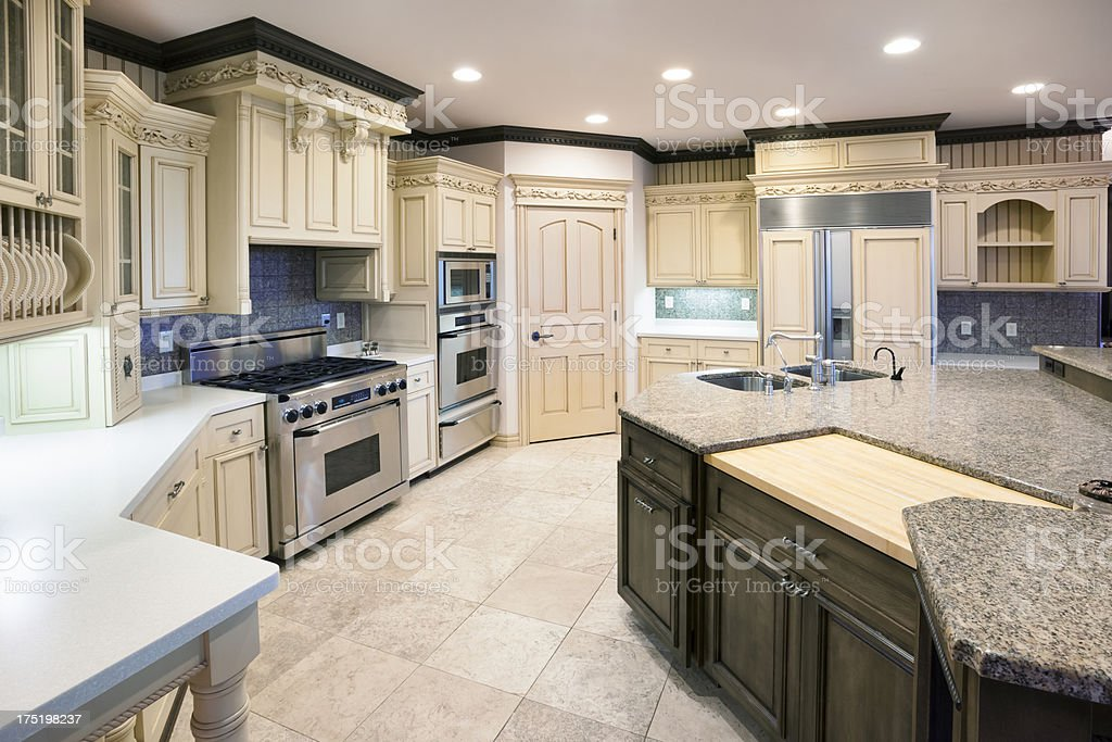 Dream Kitchen With Granite Island, Ornate Carved Woodwork stock photo