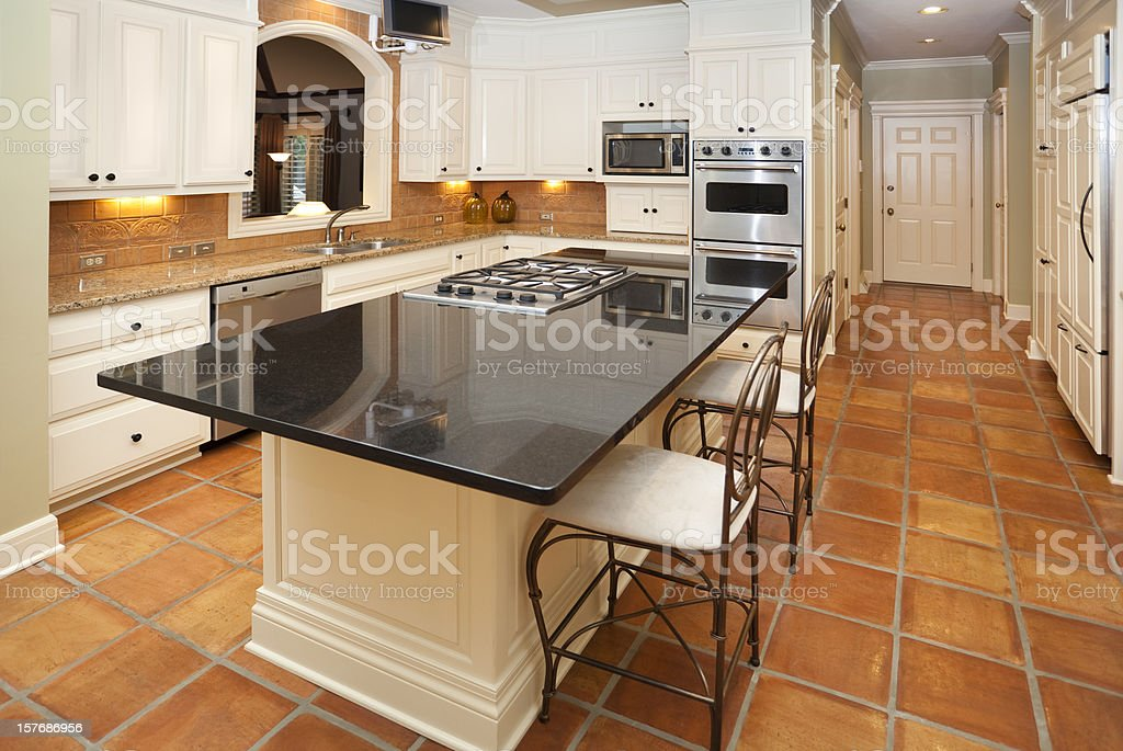 Dream Kitchen with Marble Counters, Custom Lighting, Tile Floors royalty-free stock photo