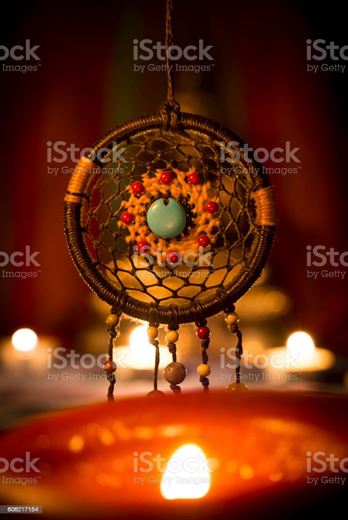 dreamcatcher and candle light. stock photo