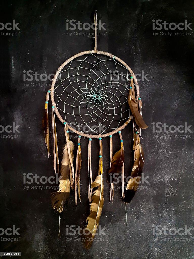 Dreamcatcher hanging on dark grey wall stock photo