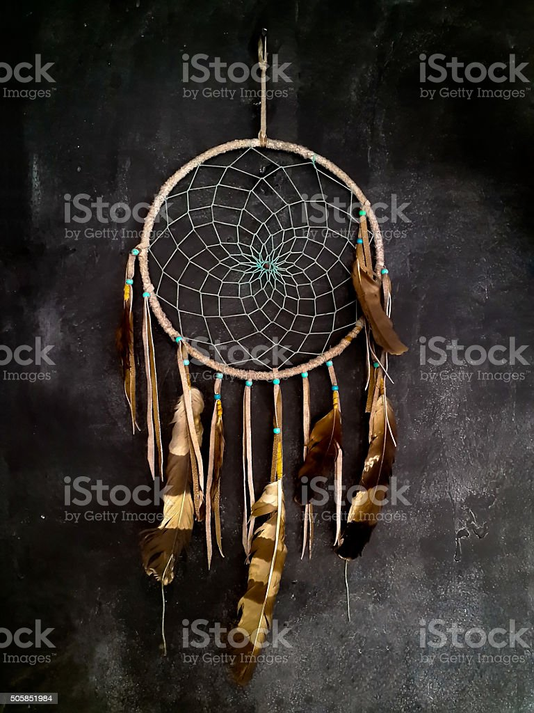 Dreamcatcher hanging on dark grey wall stock photo
