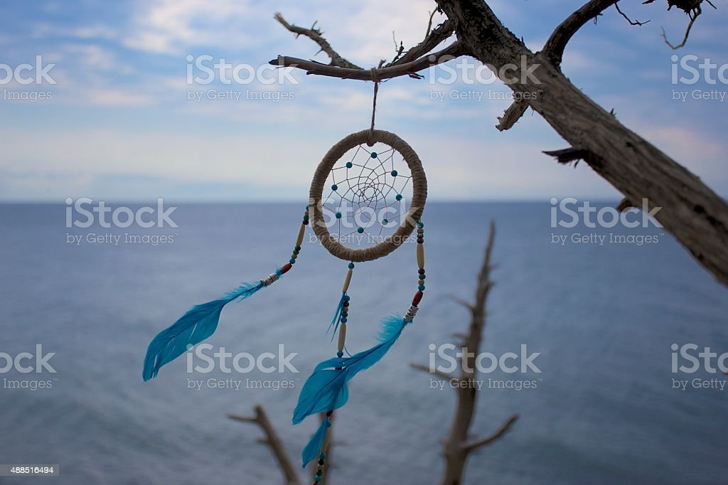 Dreamcatcher in wild natural at sunset time close-up. stock photo
