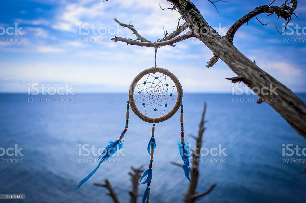 Dreamcatcher in wild natural at sunset time close-up stock photo