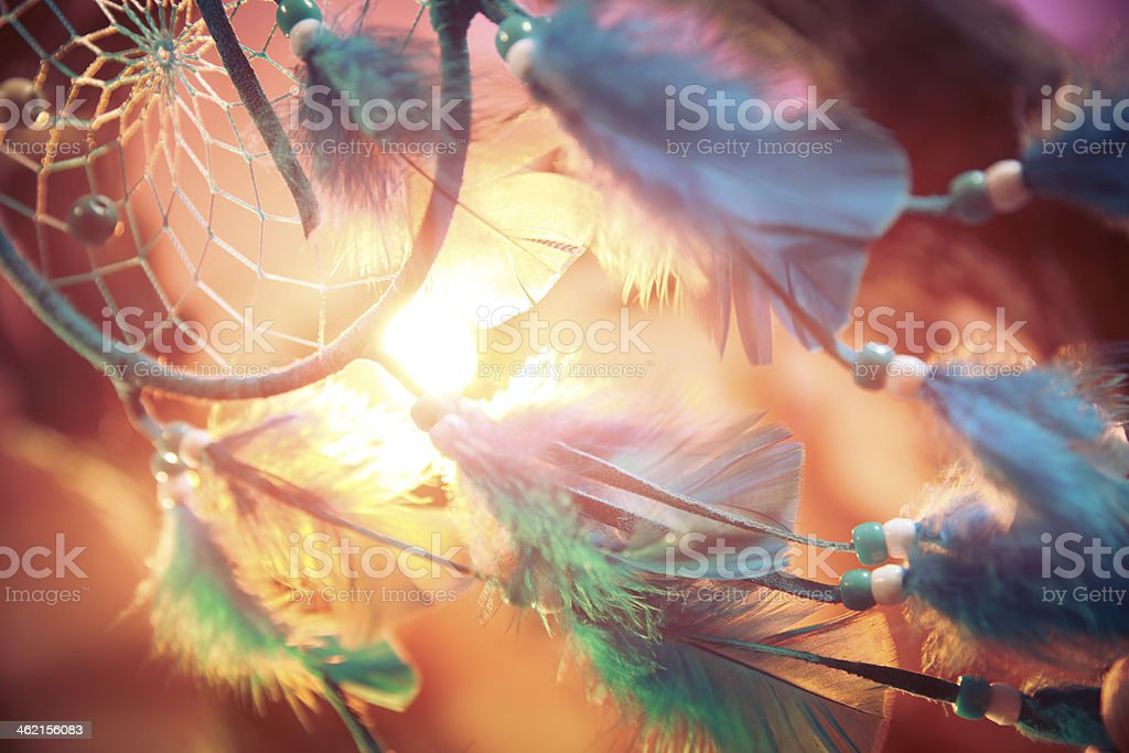 dreamcatcher on a forest at sunset stock photo