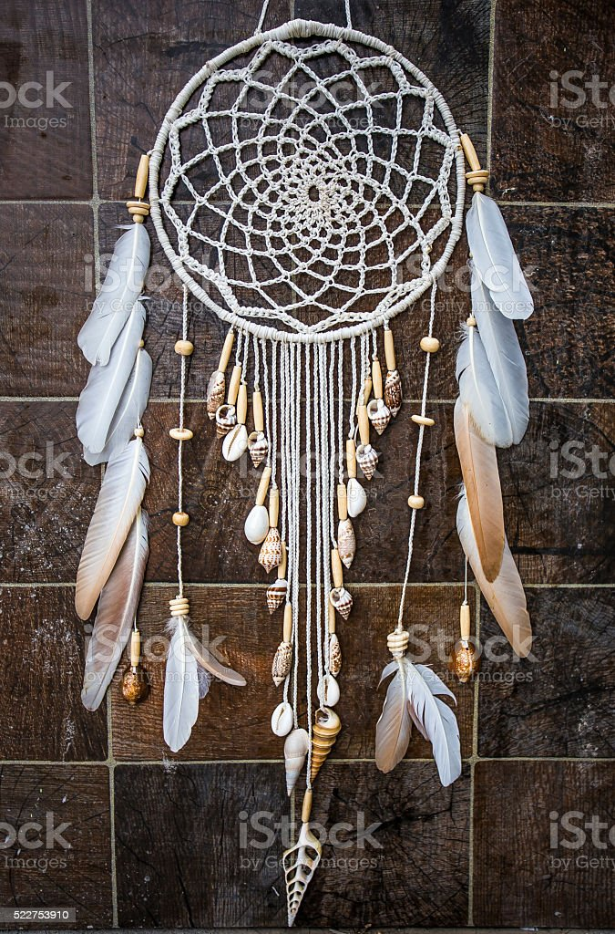 Dreamcatcher with a seashells on a stone background. stock photo